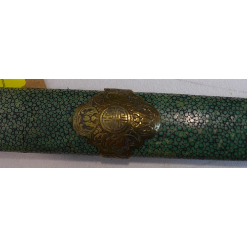 1 - A Chinese late Qing dynasty double sword, with cast brass mounts and horn grip, in shagreen covered ...