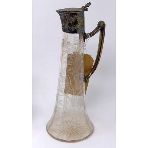 41 - A glass jug with silver plated spout and handle, decorated with ferns, H.30cm, together with four gl...