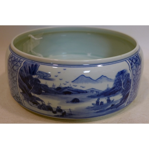 40 - A Chinese, hand-painted blue and white porcelain brush washer decorated to the exterior with two lan...