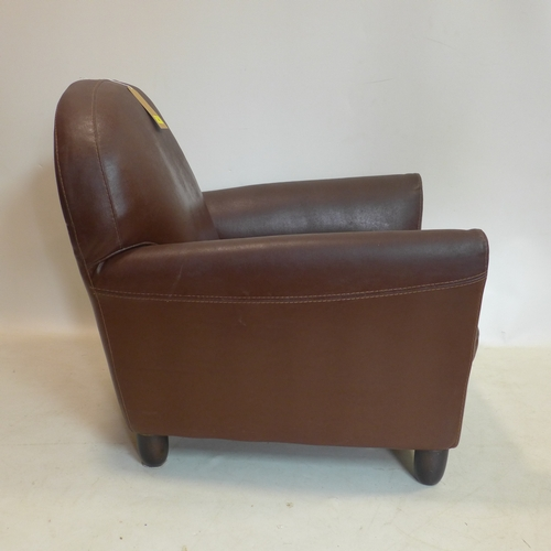 45 - A chestnut-brown leather armchair on wooden bun feet, H: 81 x W: 78 x D: 82cm...