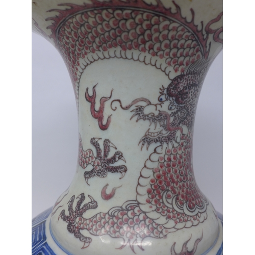 28 - A late 19th century Chinese blue and white vase, decorated with red 5 claw dragons, with six charact...