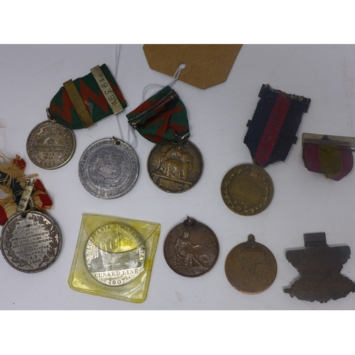 36 - A collection of nine assorted medals (9)...
