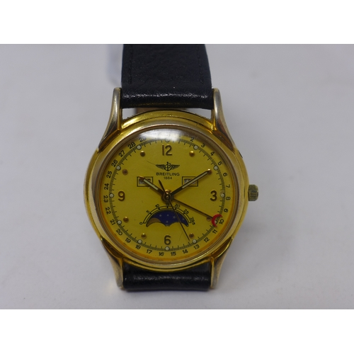 4 - A vintage Breitling gold plated gentleman's wristwatch, yellow dial with alternating Arabic numerals...