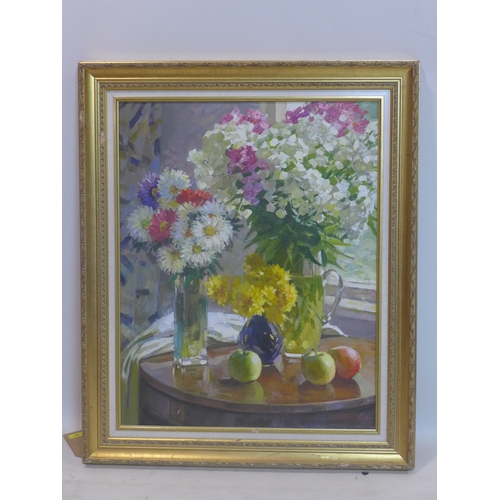 44 - A large mid 20th century, gilt framed oil on canvas of a floral still life composition in front of a...