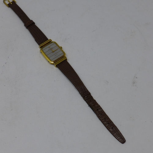 376 - A Raymond Weil 18k gold electroplated ladies wristwatch, dual tone dial, on a Hirsch Lizardgrain str...