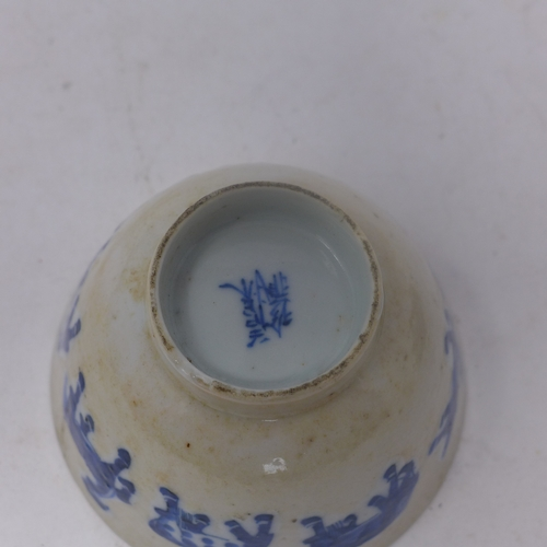 59 - An 18th century Chinese blue & white porcelain tea cup decorated with horses, with character marks t...
