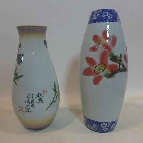183 - Two Chinese vases with floral decoration, H.38cm H.34cm...