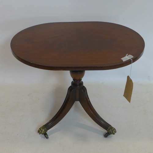 302 - A Regency style mahogany lamp table, raised on splayed legs and castors, H.50 W.62 D.46cm...
