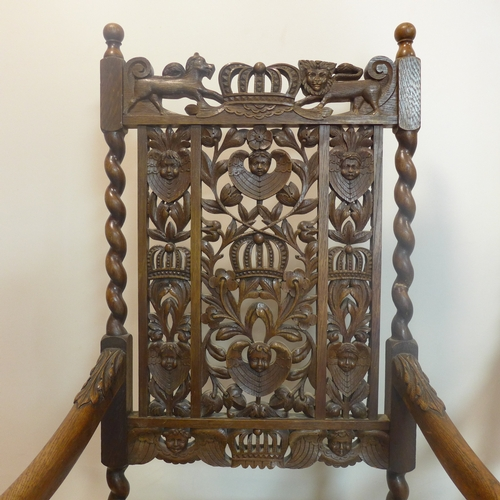 158 - A pair of 19th century carved oak throne chairs...