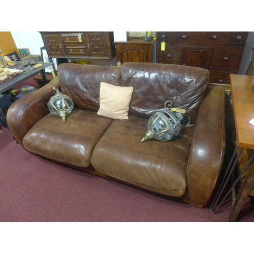 166 - A tan leather two seater sofa...