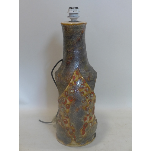 135 - A large West German pottery lamp base of abstract form in shades of grey, gold and deep red, numbere...
