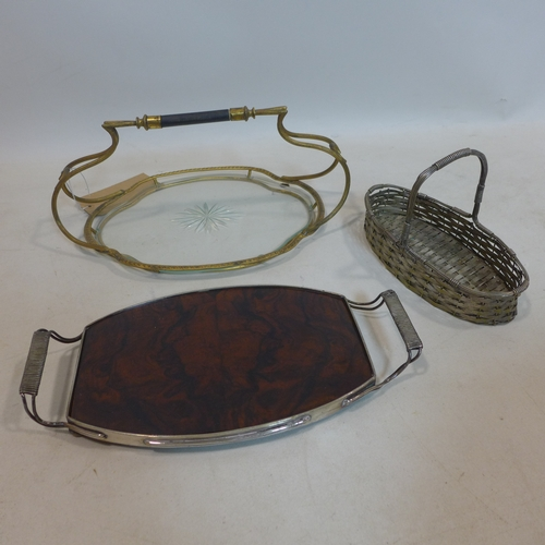 226 - A gilt metal and glass tray together with a silver plated and walnut tray and a silver plated basket...