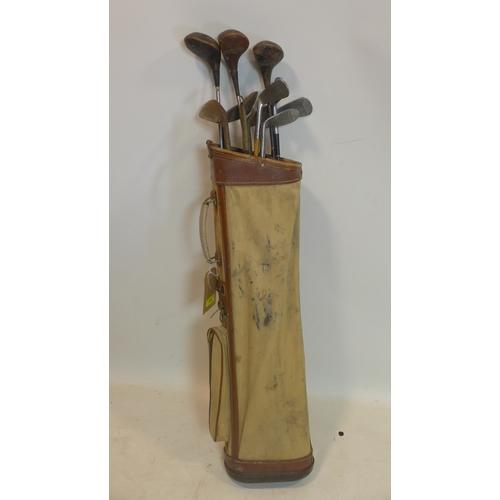 263 - A set of antique golf clubs...