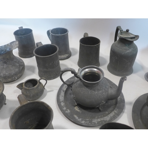 311 - A collection of antique pewter...
