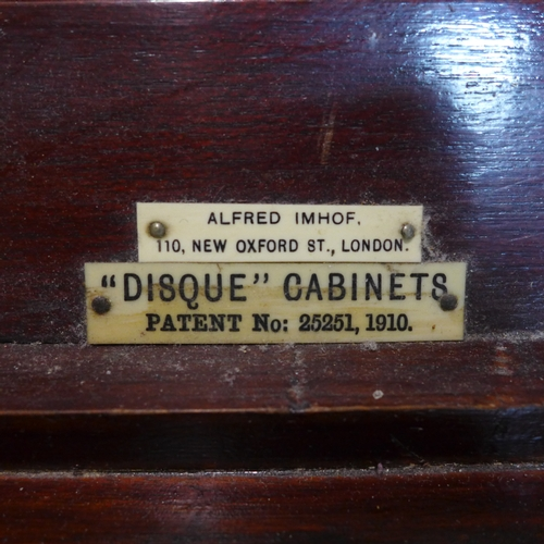 229 - A mahogany 'Disque' cabinet by Alfred Imhof, 110 New Oxford Street London, bearing plaques, cupboard...