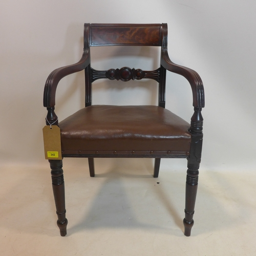 342 - A Georgian mahogany desk chair, with leather seats, raised on turned legs...