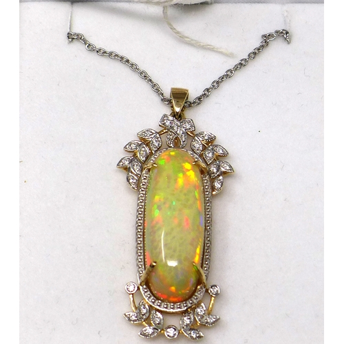 222 - A 14ct yellow and white gold, large natural, oval opal and diamond set pendant on an 18ct white gold...