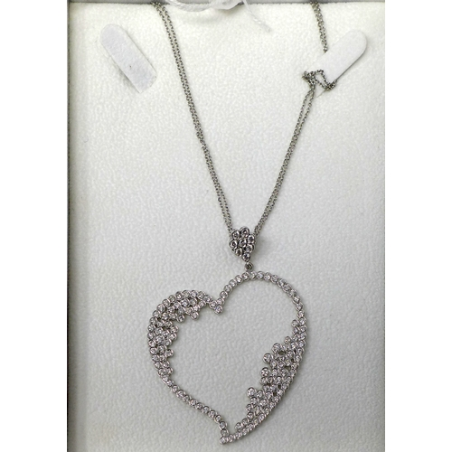 400 - An 18ct white gold heart-shaped pendant set with 4.5 carats of round brilliant cut diamonds on an 18...