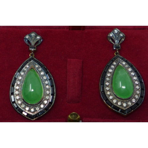 420 - A pair of yellow gold large drop earrings set with green jade cabochons framed with outer rows of on...