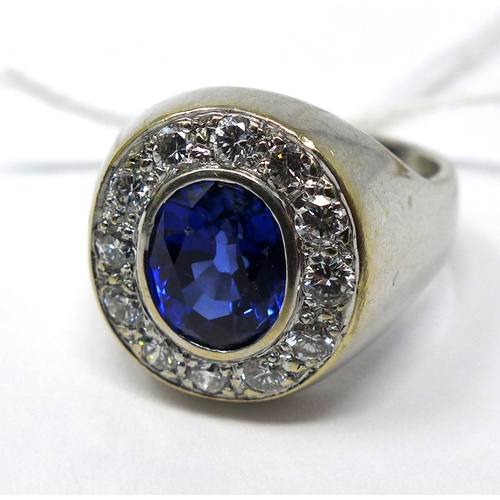 275 - An 18ct white gold brilliant-cut diamond and sapphire ring set to the centre with a faceted oval sap...