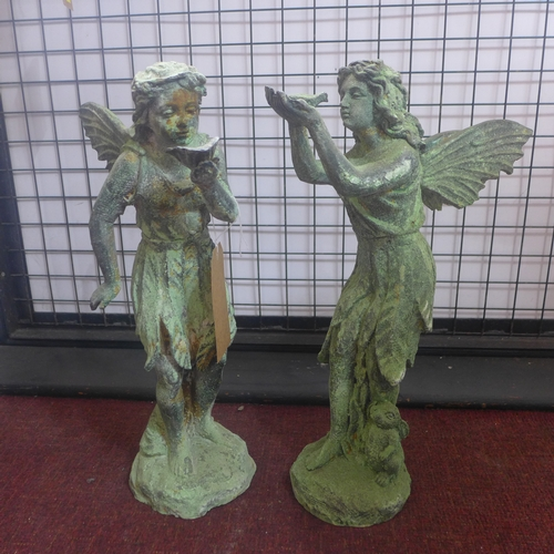 176 - Two cast iron fairies in the verdigris finish, one holding a bird, and the other holding a lily, H.5...