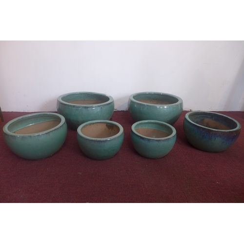199 - Two sets of three teal glazed pots, H.23cm Diameter 43cm (largest)...
