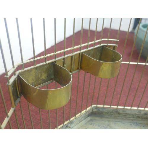 223 - A Victorian octagonal brass birdcage, H.96 W.65 D.65cm...