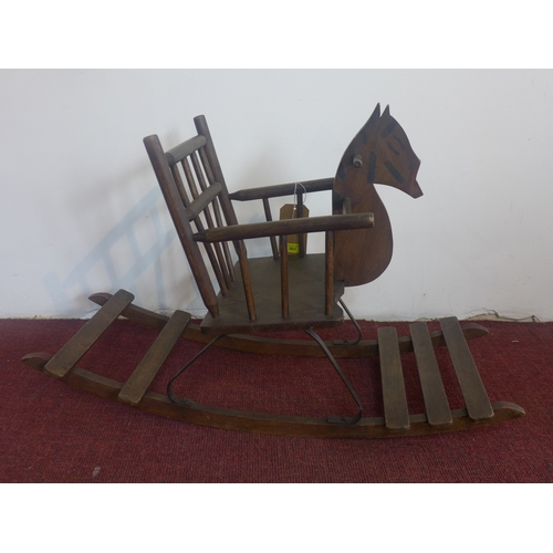 362 - An early 20th century oak child's rocking chair, with horse head, H.56 W.89 D.37cm...