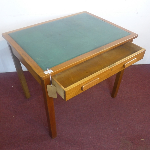 373 - An oak writing table, with green skiver above single long drawer, raised on square chamfered legs, H...