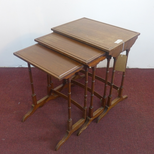 378 - A nest of three early 20th century tables, on turned supports, H.58 W.49 D.34cm...