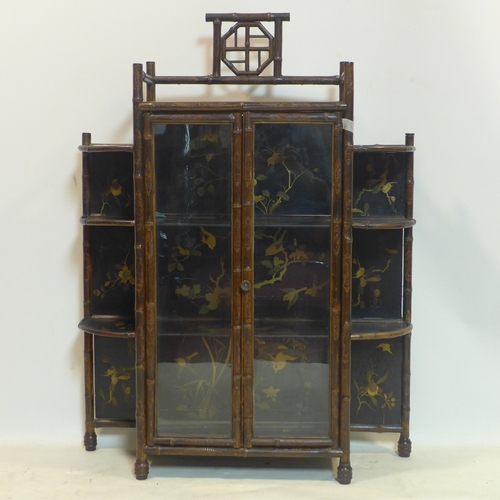 186 - A Japanese bamboo lacquered cabinet, the lacquered panels gilt decorated with birds and insects on b...