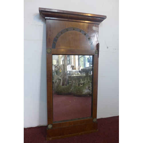 225 - An Empire period inlaid and brass mounted mahogany pier mirror, with moulded cornice above rectangul...