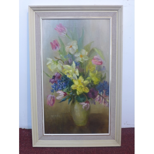 26 - Nin Parker, British, A 20th century framed oil on canvas of a floral still life composition, signed ...