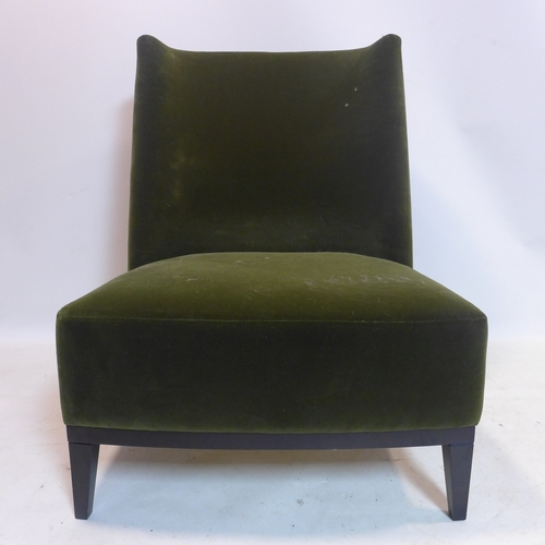 260 - A large green velour upholstered chair, on ebonised square tapered feet...