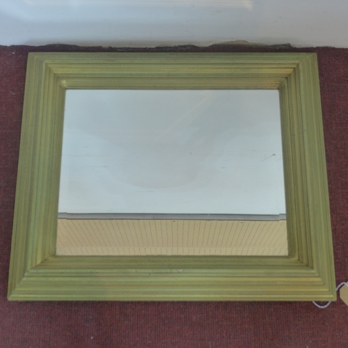 344 - A rectangular gilt painted wall mirror, with bevelled glass plate, 58 x 68cm...