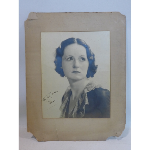 57 - A large circa 1920's monochrome signed photograph of a female singer signed 'with best wishes, Eilee...