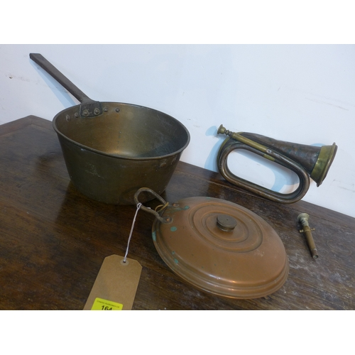 164 - A 19th century large brass pan 13 x 27cm with a circular copper hot water bottle dia: 23cm and a bra...