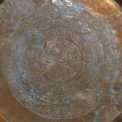 237 - A Middle Eastern copper charger, with engraved geometric design to centre, Diameter 48cm...