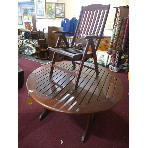345 - A teak garden set by Botany Bay Inc., including a large circular table with Lazy Susan and six adjus...