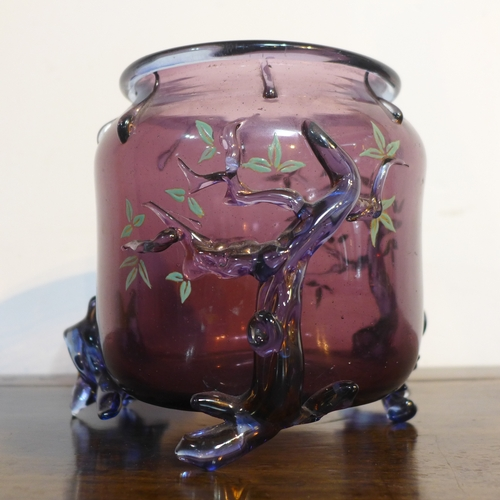 64 - A 20th century glass jardiniere in amethyst-coloured glass on 3 blue glass feet in the form of trees...