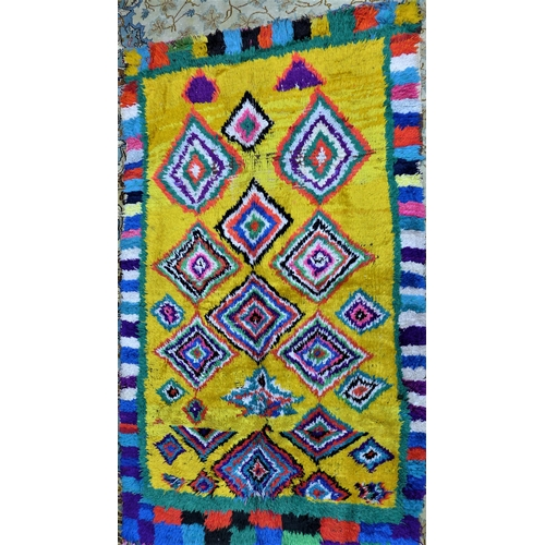 14 - A vintage Moroccan Berber Azilal rug, with diamond medallions on a yellow ground, 190 x 111cm...