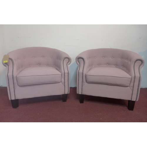 163 - A pair of tub chairs with studded pink upholstery, on square tapered feet...