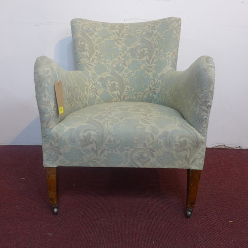 188 - An early 20th century armchair, with floral upholstery, on tapered legs and castors, H.76cm...