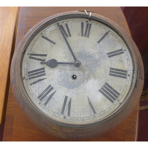 157 - An early 20th century circular wall clock with a white-painted circular metal dial with black Roman ...
