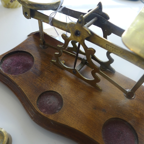 51 - An antique brass and mahogany Post Office scales complete with all 10 brass weights, Scales: 13 x 24...