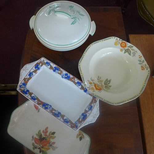 65 - A large collection of English Art Deco ceramics to include 2 lidded tureens, 6 bowls and others...