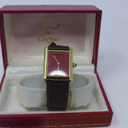 79 - A vintage Must de Cartier Tank Vermeil ladies wristwatch, with Bordeaux dial, silver gilt case marke...
