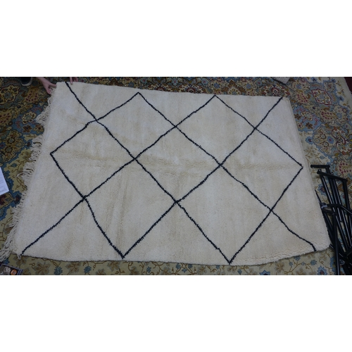 27 - A Moroccan Berber Beni Ourain rug, with diamond design, 255 x 168cm...