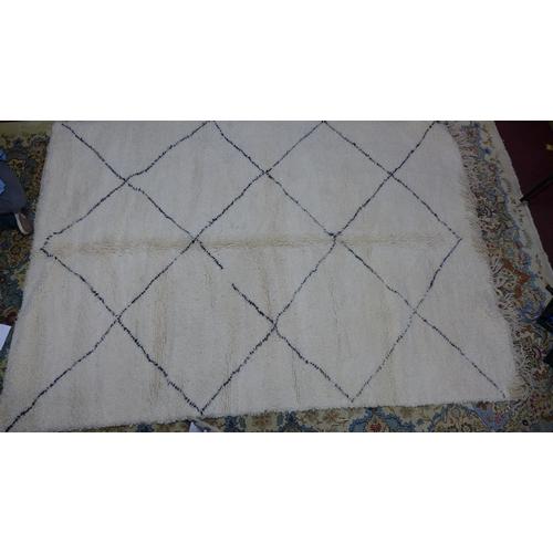 31 - A Moroccan Berber Beni Ourain rug, with diamond design, 314 x 212cm...