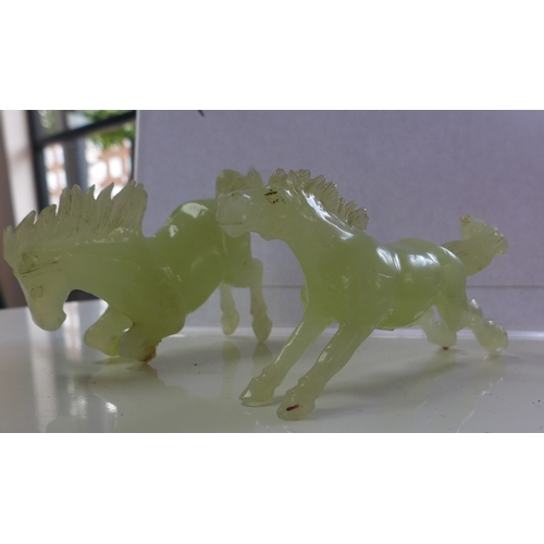 314 - Two 20th century, Chinese carved green jade horses 6 x 12cm and 8 x 13cm...